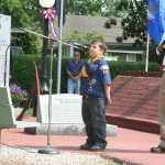 cub scout leading pledge of allegiance at memorial day service
