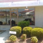 morgan insurance agency storefront with buy local sign