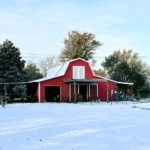 fair haven farms red barn with snow on ground and roof